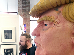 Naked Donal Trump statue and artist
